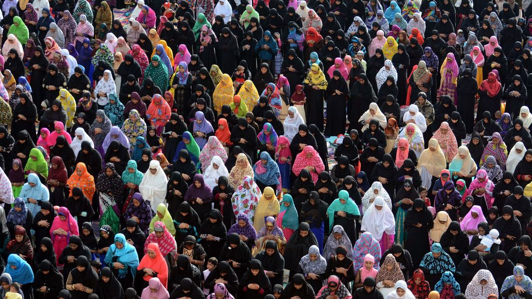 Indian Muslim devotees offer Eid al-Adha prayers in the grounds of a school in Chennai on September 24, 2015