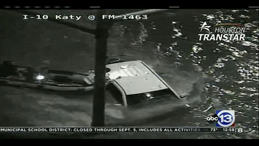 CCTV films a man being rescued from his his almost completely submerged car