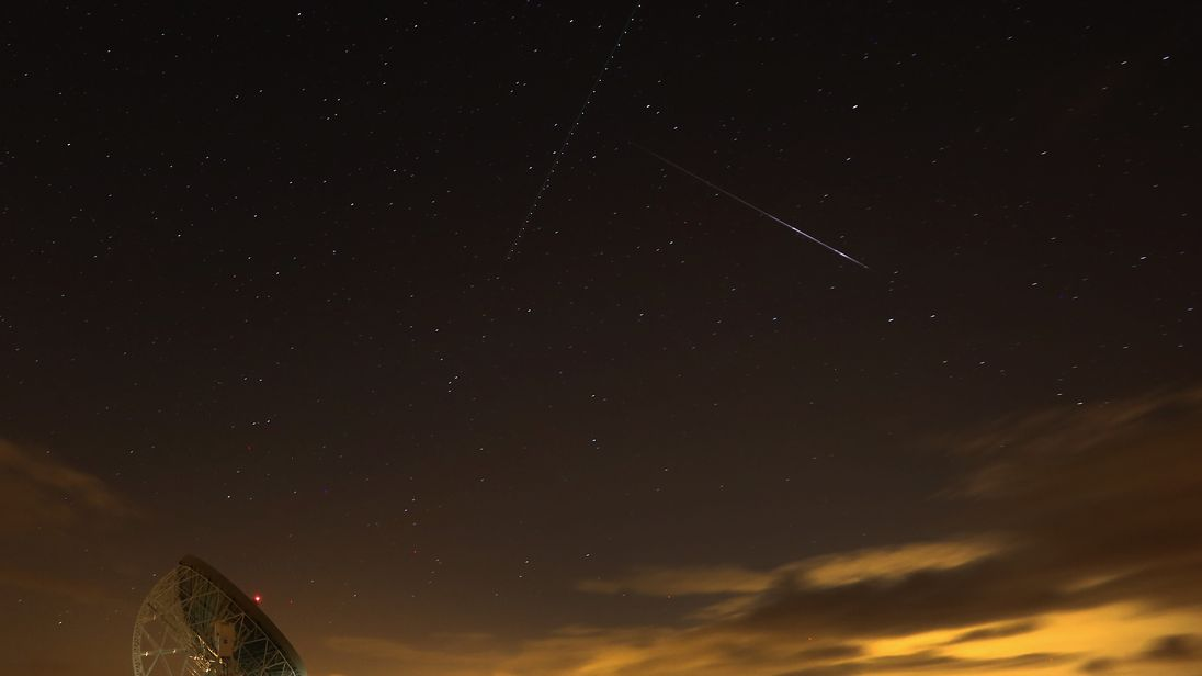 A Perseid meteor streaks across the sky above the Lovell Radio Telescope at Jodrell Bank in 2013