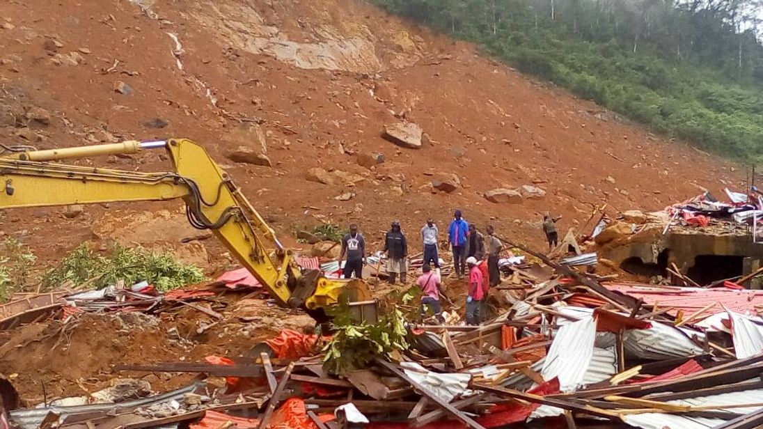 People were seen sifting through the rubble to search for their loved ones. Pic: Society 4 Climate Change Communications Sierra Leone volunteers