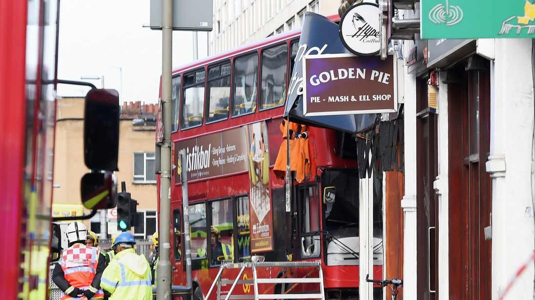 Emergency services at the scene in southwest London after a bus hit a shop