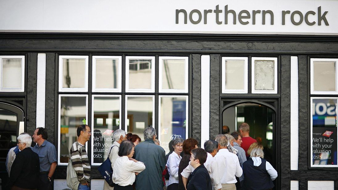 File picture of customers queue to enter a Northern Rock bank branch in Bromley, in south-east London, on September 14, 2007