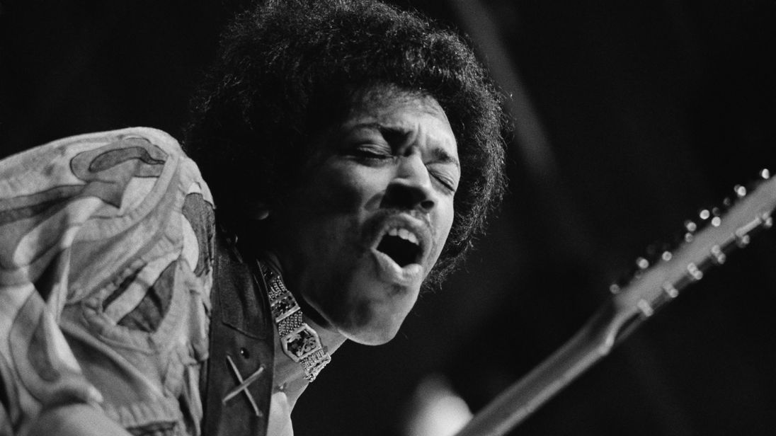 Hendrix (1942 - 1970) caught mid guitar-break during his performance at the Isle of Wight Festival, August 1970