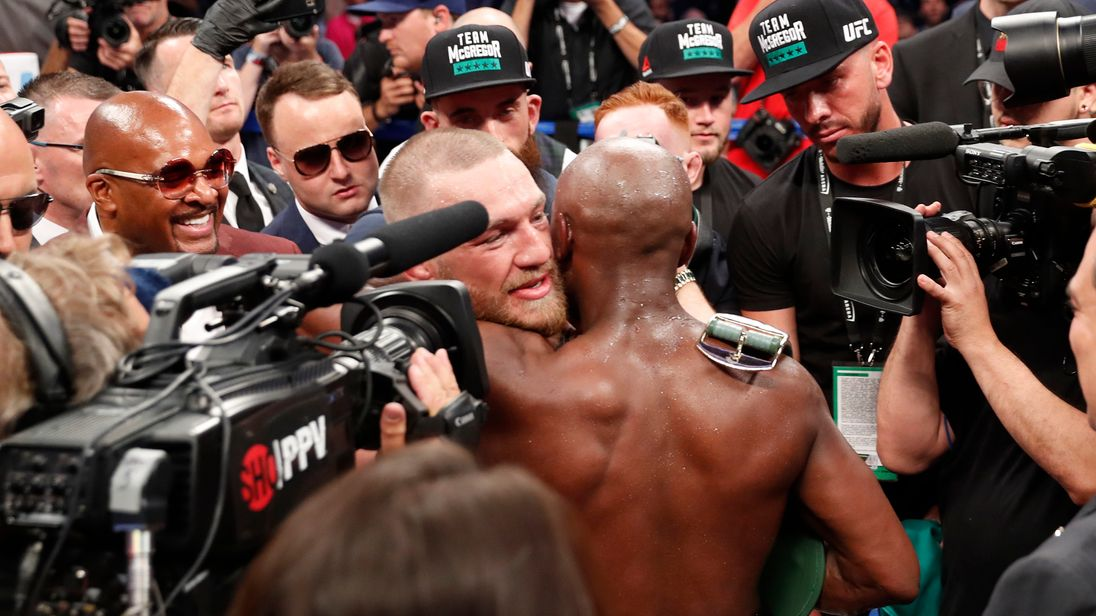 The fighters embrace after a bout that was predicted to generate $600m