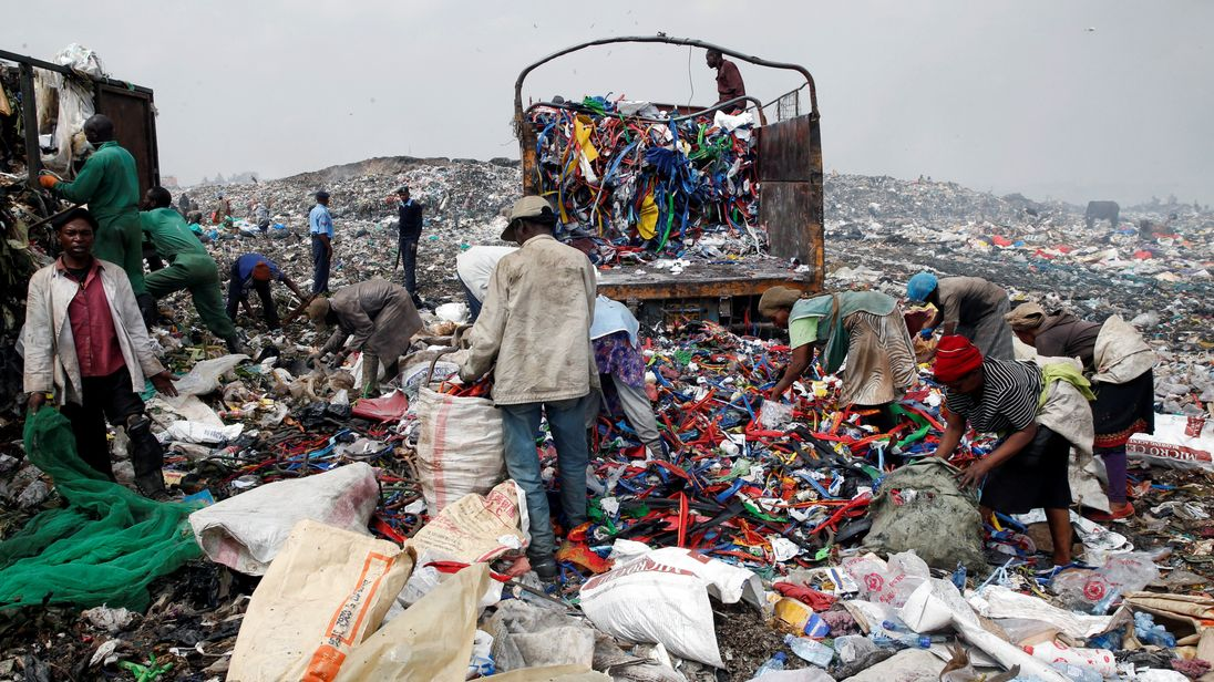 Scavengers sort recyclable plastic materials at the Dandora dumping site on the outskirts of Nairobi, Kenya August 25, 2017. Picture taken August 25, 2017. REUTERS/Thomas Mukoya