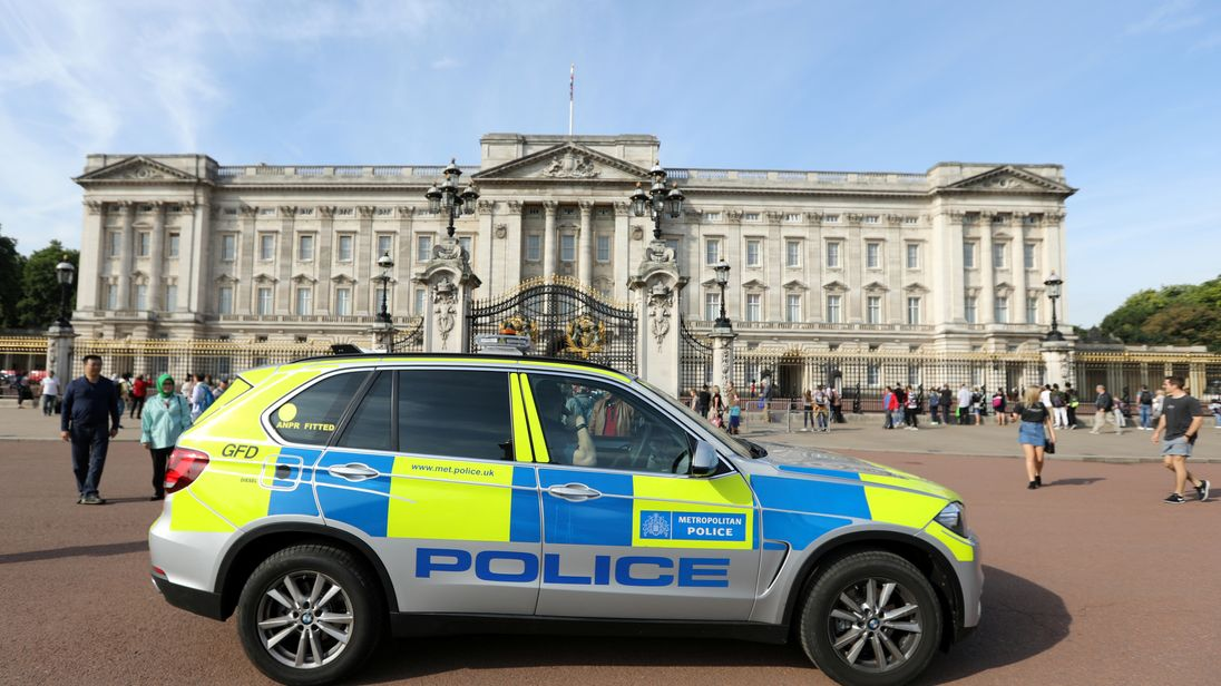 A police vehicle patrols outside Buckingham Palace