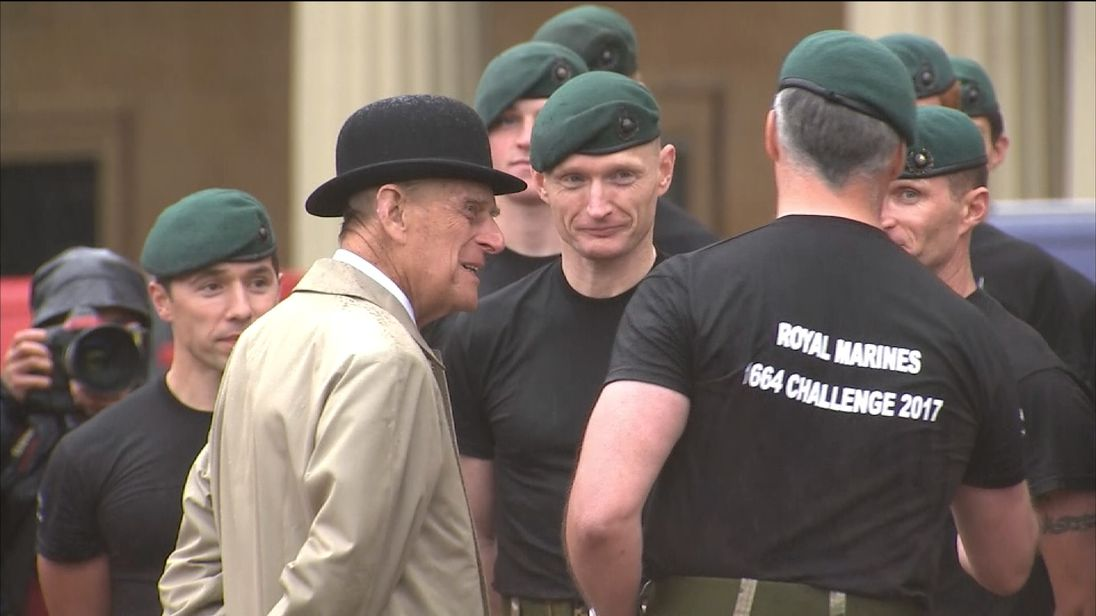 Prince Philip meets with Royal Marines during his final solo royal engagement before retirement