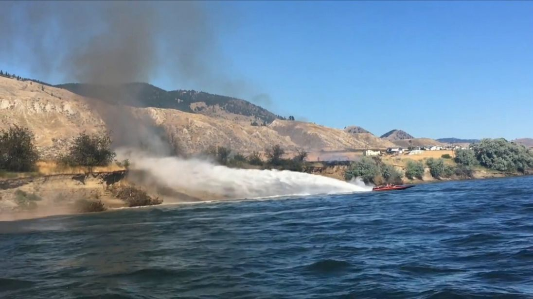 The spray from the boat doused the flames Pics: Lorrie Jane Arnott