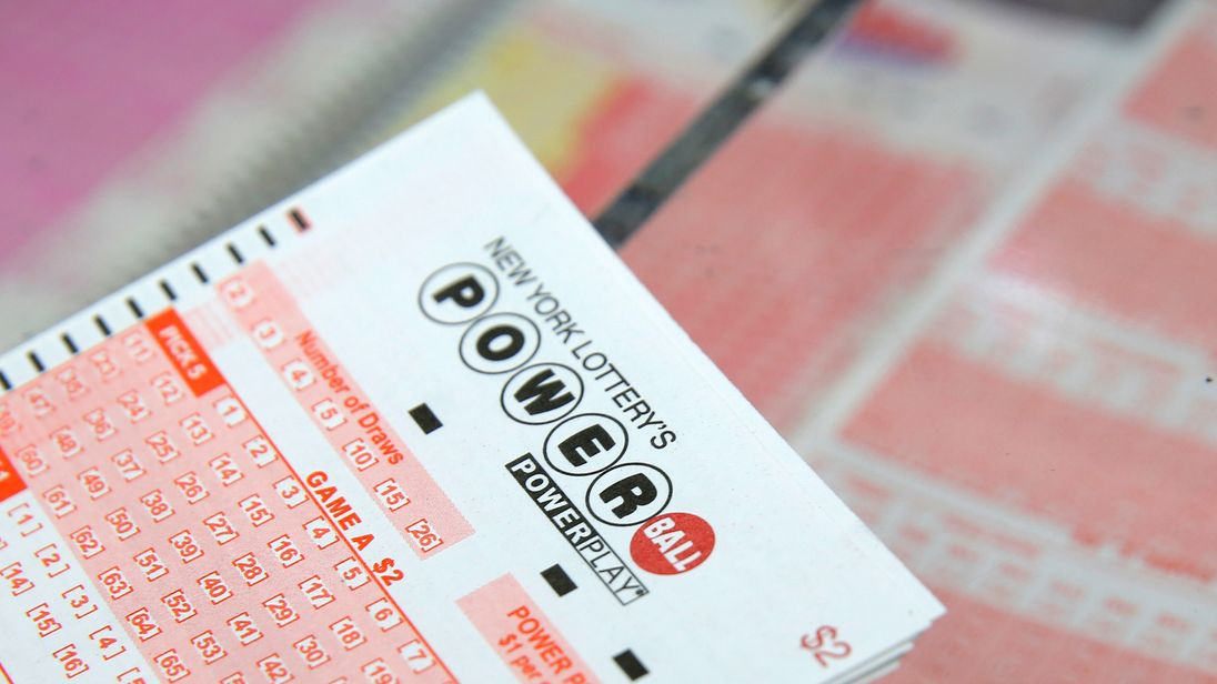 A US Powerball lottery ticket sits on a counter at a store in New York