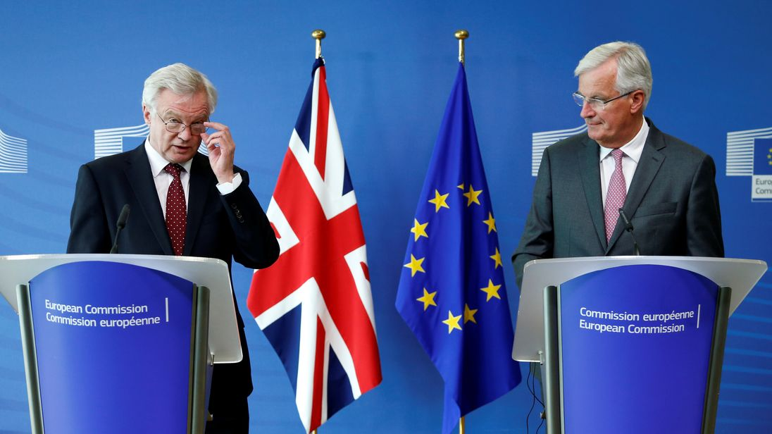 David Davis (L) and European Union's chief Brexit negotiator Michel Barnier talk to the media ahead of third round of Brexit talks in Brussels