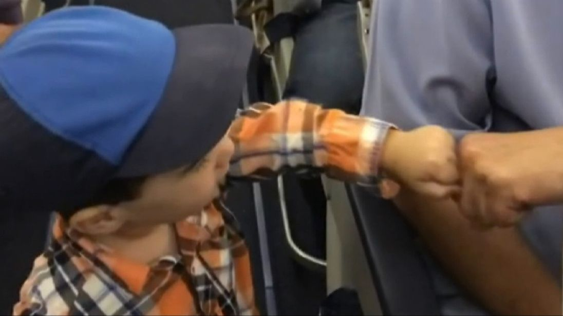 Two-year-old boy fist bumps other passengers on US plane