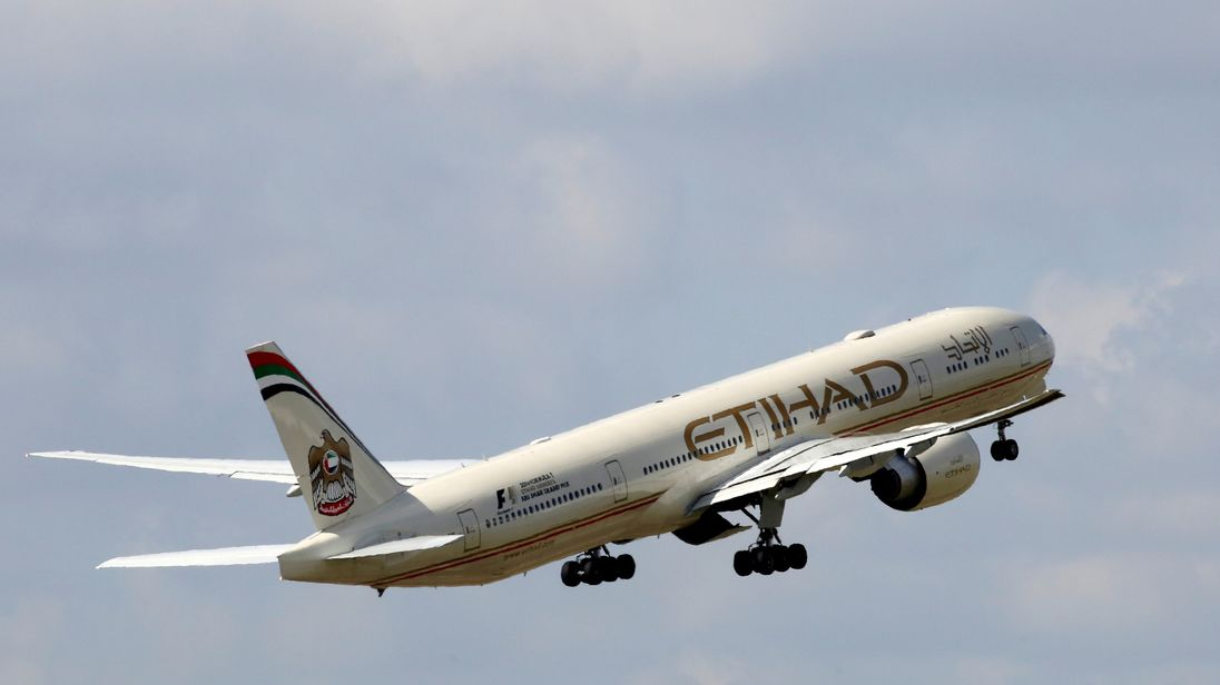 An Etihad Airways Boeing 777-3FX aircraft takes off at the Charles de Gaulle airport in Roissy, France, August 9, 2016