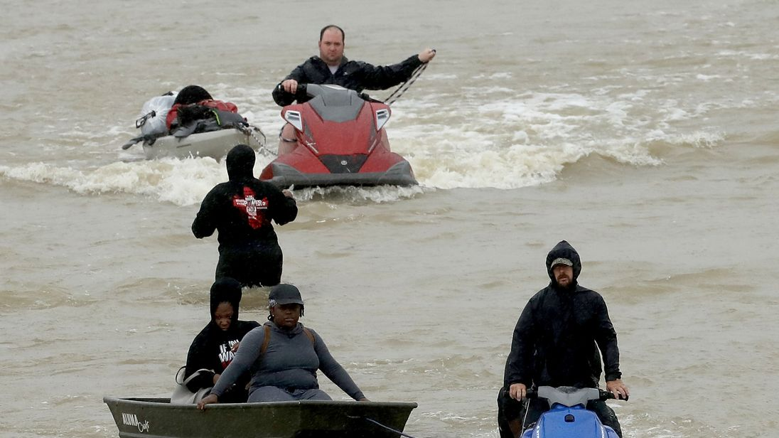 Residents are rescued using jet skis in Houston
