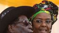 President Robert Mugabe and his wife Grace attend a rally in Chinhoyi