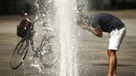 A man refreshes himself with the waters of a fountain at Piazza Castello in Turin on August 2, 2017, as they seek relief during a heatwave that continues to grip southern Europe. / AFP PHOTO / Marco BERTORELLO (Photo credit should read MARCO BERTORELLO/AFP/Getty Images)