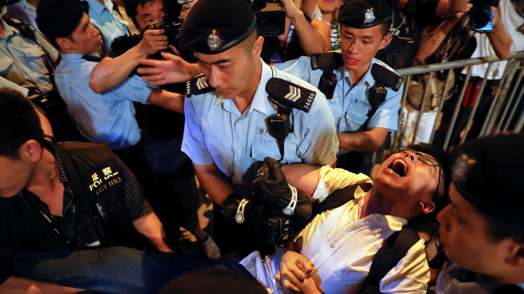 Seven Hong Kong Policemen Jailed for Assaulting Activist