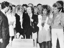June 1986: Prince Charles and pop stars look on as Princess Diana cuts a cake to mark the tenth year of the Prince's Trust at a charity rock concert at Wembley