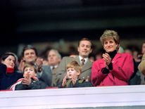 Feb 1992: Diana, William, and Harry applaud during the Wales vs France Five Nations Cup match at Cardiff Arms Park