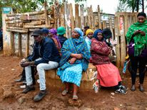 People wait to cast their ballot at a polling station in Eldoret.