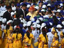Indian Prime Minister Narendra Modi is surrounded by schoolchildren participating in the country's 71st Independence Day celebrations