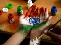 An Indian student gets their hand painted with the Indian national flag at celebrations in Chennai