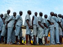 Inmates wait to cast their vote in a maximum security prison in Kisumu on Lake Victoria