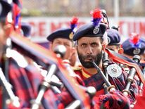 A Jammu and Kashmir police band performs during celebrations marking India's Independence Day