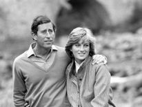Aug 1981: Charles and Diana take a break during their country stroll along the banks of the River Dee, during their holiday at Balmoral Castle