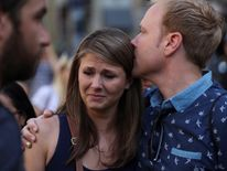 People react in the area where a van crashed into pedestrians at Las Ramblas street in Barcelona