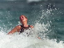 Jan 1993: Diana enjoys the splash of a wave during a morning swim on the Caribbean Island of Nevis