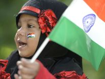 An Indian girl holds a flag during Independence Day celebrations in Secunderabad