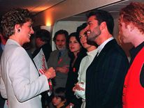 Dec 1993: Diana , Patron of the National AIDS Trust chats with singer George Michael before the start of the Concert of Hope in London to mark World AIDS Day