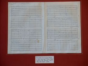 The original handwritten music score for the Beatles song Eleanor Rigby, signed by George Martin and Paul McCartney