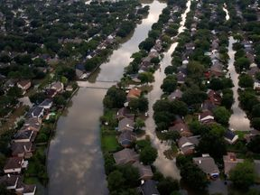 Houses are seen partially submerged in flood waters caused by Tropical Storm Harvey in Northwest Houston...