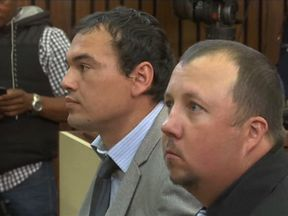 Willem Oosthuizen and Theo Jackson, who were found guilty of forcing a black man into a coffin