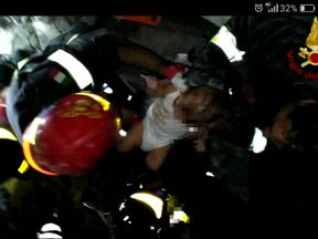 A baby is pulled alive from rubble following the Ischia earthquake