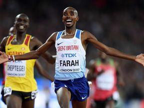 Sir Mo Farah celebrates his 10,000 metres victory