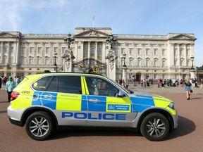 A police vehicle patrols outside Buckingham Palace