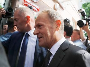 President of the European Council Donald Tusk (R) arrives at the prosecutor's office