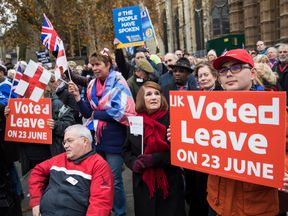 Pro-Brexit demonstrators protest outside the Houses of Parliament on November 23, 2016 in London, England