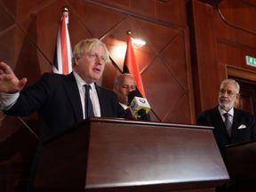 Boris Johnson speaks alongside Mohamed al-Taher Siala of the Libyan Government of National Accord