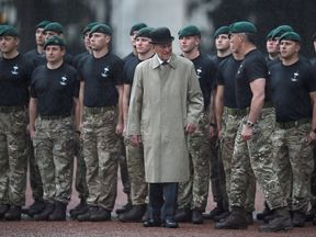 Prince Philip meets Royal Marines during his final solo royal engagement before retirement