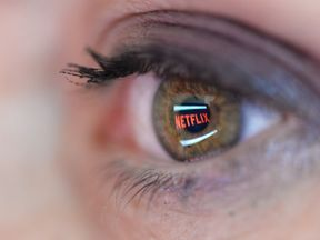 In this photo illustration the Netflix logo is reflected in the eye of a woman on September 19, 2014 in Paris, France