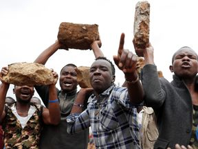 Supporters of opposition leader Raila Odinga hold up boulders in front of a barricade in Kawangware slum in Nairobi, Kenya, August 10, 2017. REUTERS/Goran Tomasevic