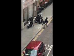 The six robbers smashed their way through the exclusive jewellery cases inside the shop