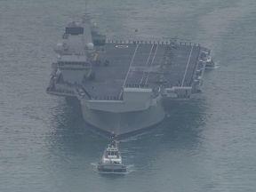 HMS Queen Elizabeth arrives at Portsmouth