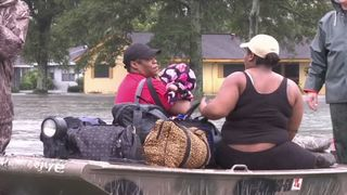 A family is taken to safety in Texas after their home is flooded