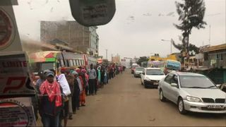 People wanting to vote in Kenya's elections queue in Kasarani, Nairobi