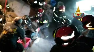 Babies are rescued from earthquake damaged buildings in Italy