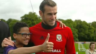 A young fan is delighted to meet his favourite player, Gareth Bale